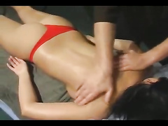 Topless model gets her body massaged onstage